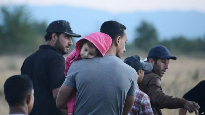 Syrian refugees wait near the border train station of Idomeni, northern Greece, to be allowed by the Macedonian police to cross the border from Greece to Macedonia on Tuesday, 18 August 2015