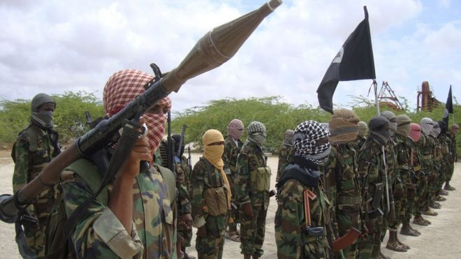 Al-Shabab fighters display weapons as they conduct military exercises in northern Mogadishu, Somalia