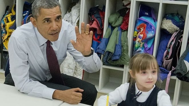 Obama raising his hand in the classroom