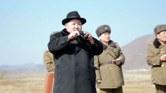 Photo released by North Korea's official Korean Central News Agency on 21 February 21 shows Kim Jong-un (C) inspecting a flight drill of fighter pilots at an undisclosed location.