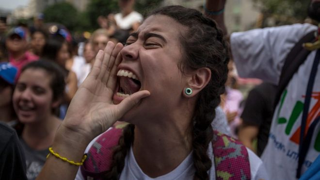 A woman shouts during a demonstration in Caracas, Venezuela, 26 October 2016