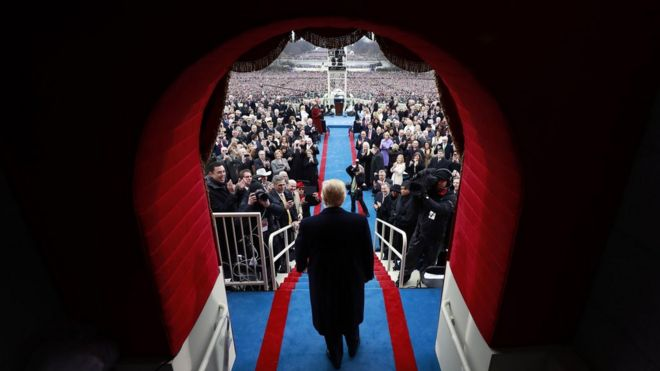 President-elect Donald Trump arrives to applause at the inauguration ceremony