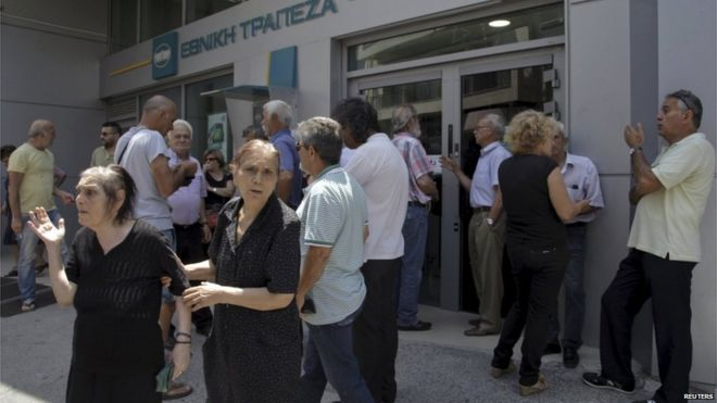 Pensioners wait for their monthly payments in Crete (29 June)