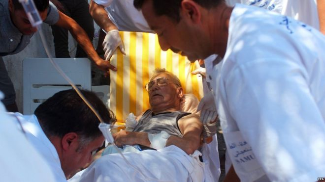 Medics help an injured man in Sousse