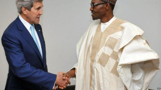 John Kerry shakes hands with Muhammadu Buhari in Abuja on 29 May 2015