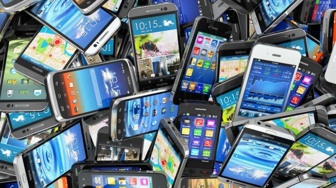 a pile of smartphones