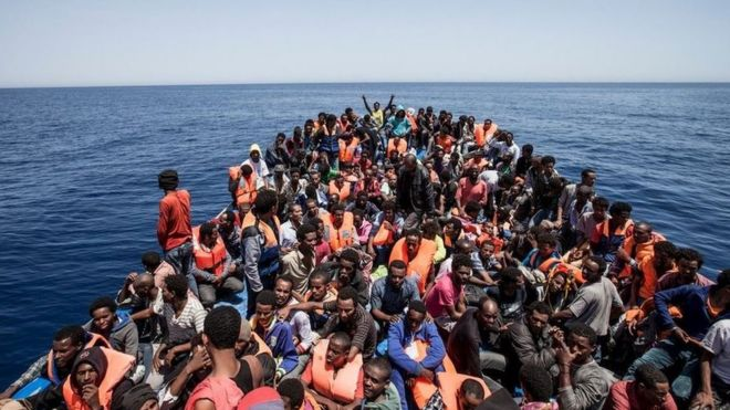 Boat crammed with migrants at sea