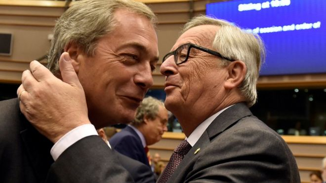 European Commission President Jean-Claude Juncker welcomes Nigel Farage at the European Parliament