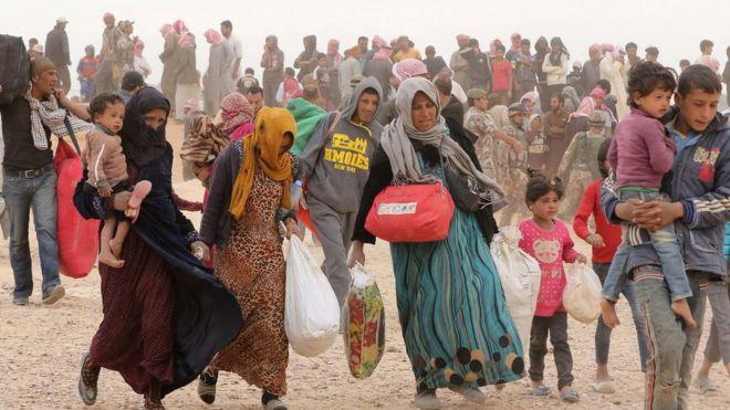 Syrian refugees waiting to enter Jordan in May 2016