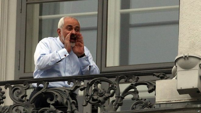 Mohammad Javad Zarif shouts to reporters outside the Palais Coburg hotel in Vienna (13 July 2015)