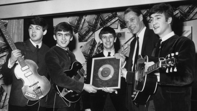 George Martin with the Beatles in April 1963