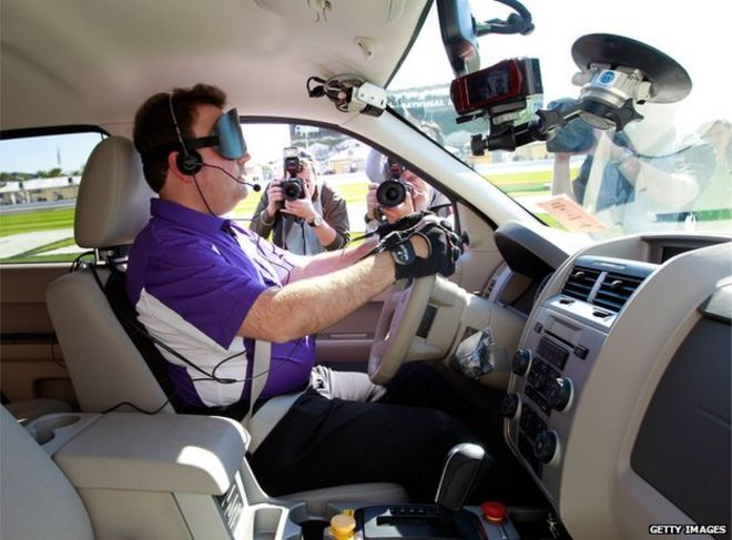Blind driver in adapted car