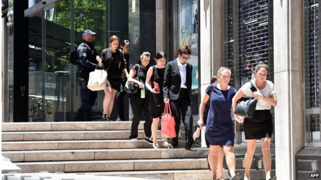armed police evacuate employees from the offices next to a cafe in the central business district bbc sydney offices office