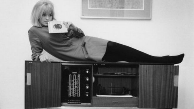 Annie Nightingale on a record player, 1964