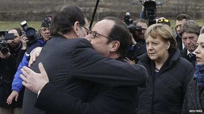 President Francois Hollande (centre) embraces Spains Prime Minister Mariano Rajoy as German Chancellor Angela Merkel looks on. Limo taxi Car