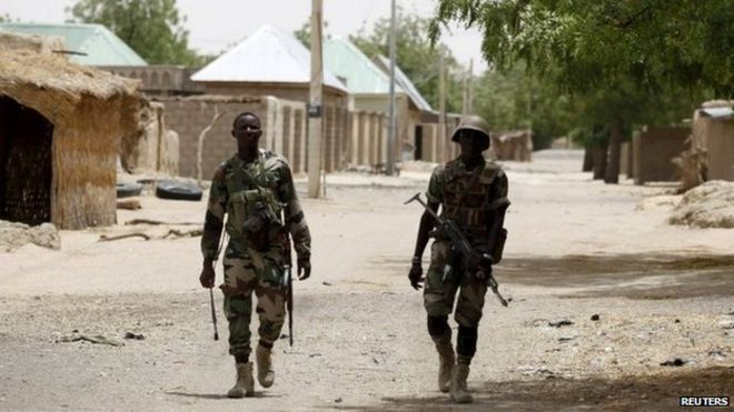 Nigerien soldiers patrol on foot in the recently recaptured northern town of Damasak on 24 March 2015