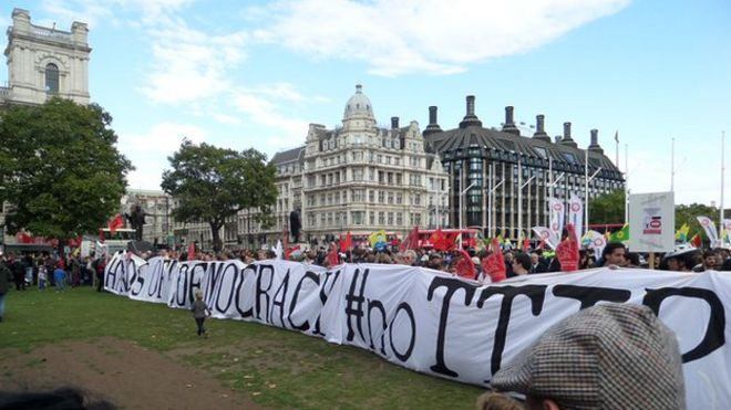 Protesters in London demonstrating against TTIP
