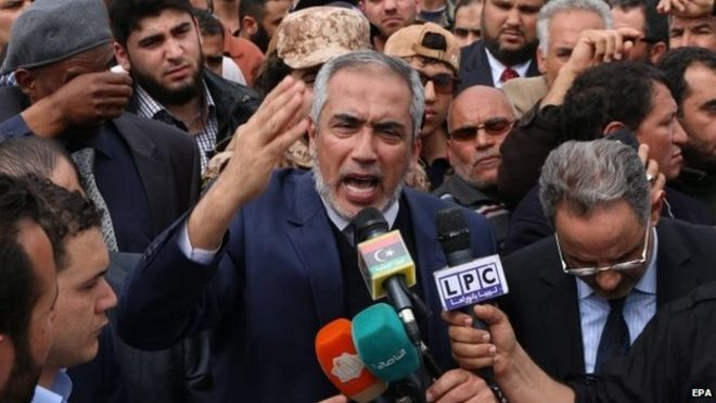 """Omar al-Hassi speaks during the funeral for slain Fajr Libya leader Saleh Al-Baraki at Martyrs"""" Square in Tripoli , Libya, 22 March 2015."""