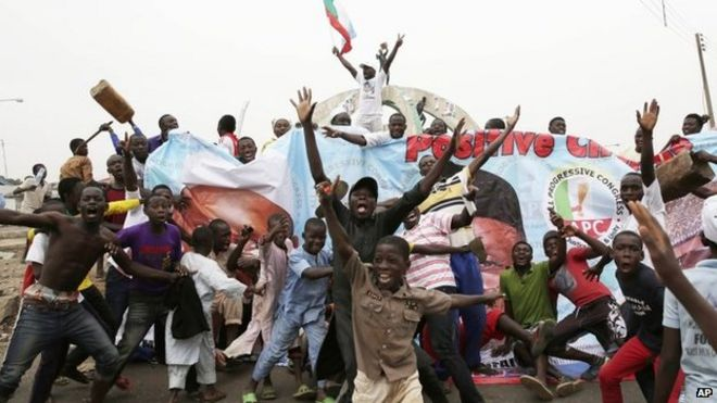 Residents celebrate the anticipated victory of Presidential candidate Muhammadu Buhari in Kaduna, Nigeria 31 March 2015