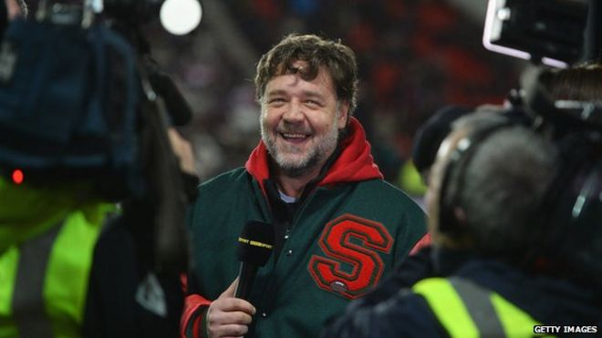 Actor and co-owner of South Sydney Rabbitohs Russell Crowe is interviewed by the BBC prior to the World Club Challenge match between St Helens and South Sydney Rabbitohs at Langtree Park on 22 February 2015 in St Helens, England.