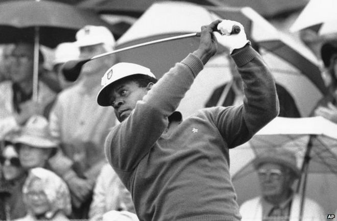 Lee Elder tees off in the first round of play at the Masters in Augusta in 1975