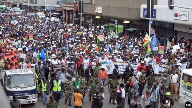 "Thousands of people take part in the ""peace march"" against xenophobia in Durban, South Africa, on 16 April 2015"