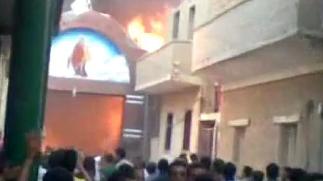 A Coptic church on fire in Kerdasa on 14 August 2013