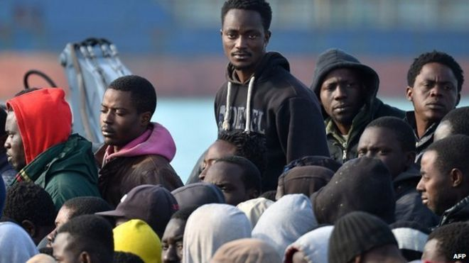 Rescued migrants disembark at the Sicilian harbour of Catania on 23 April 2015
