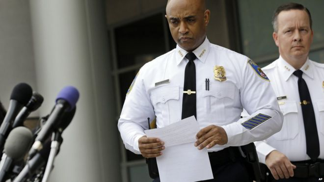 Anthony Batts and another officer approach the microphone