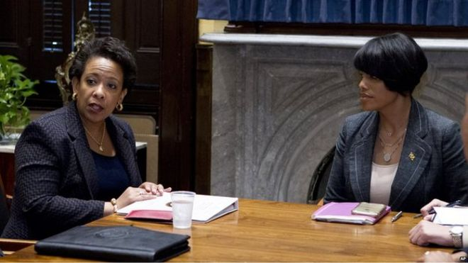 Loretta Lynch and Stephanie Rawlings-Blake sitting at a table