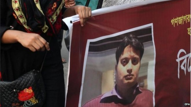 Poster of Bangladeshi blogger Ananta Bijoy Das held by activists protesting against his killing, in Dhaka, Bangladesh, 12 May 2015.