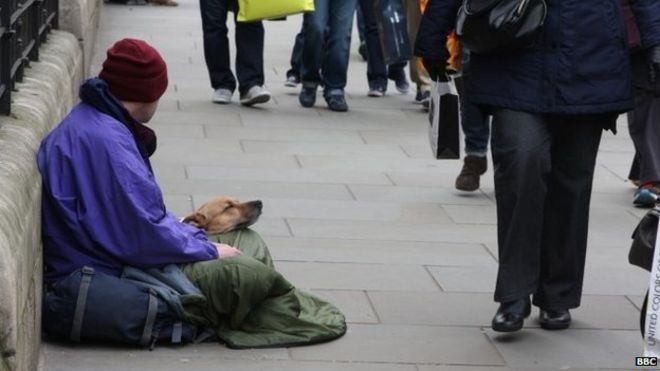 Homeless man on a London street with his dog. 01/04/2015.