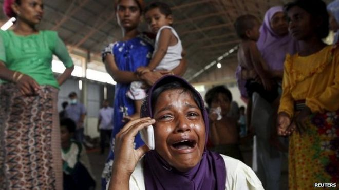 A Rohingya migrant who arrived in Indonesia by boat cries while speaking on a mobile phone with a relative in Malaysia, at a temporary shelter in Kuala Langsa in Indonesia's Aceh Province, 16 May 2015