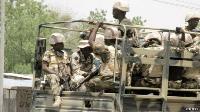 Soldiers are seen on a truck in Maiduguri in Borno State, Nigeria May 14, 2015