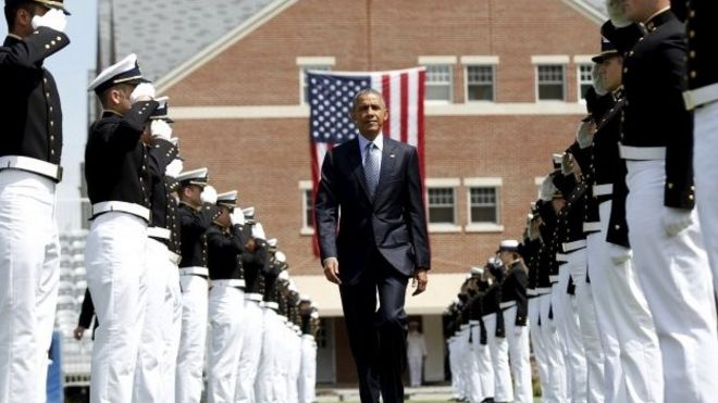 U.S. President Barack Obama walks through an honor cordon as the arrives for the 134th Commencement Exercises of the United States Coast Guard Academy in New London, Connecticut May 20, 2015.