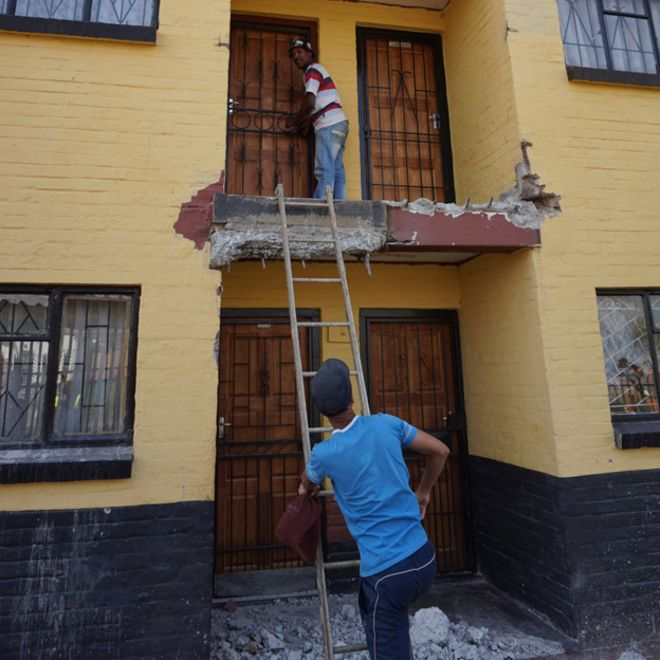 residents using stepladder