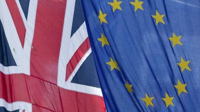 The Union Jack flag next to the European Flag
