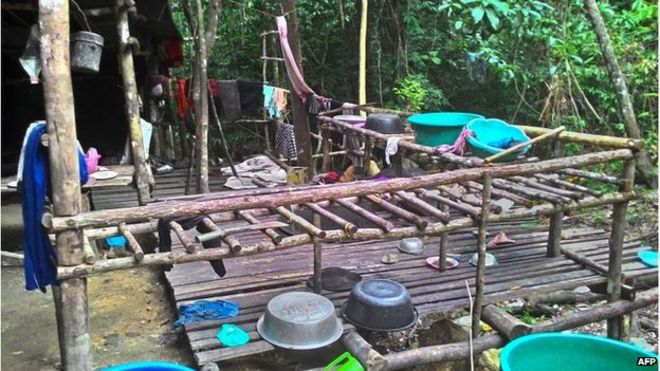 This undated handout photo made available on 25 May 2015 by the Royal Malaysian Police shows an abandoned migrant detention camp used by people-smugglers in a jungle near the Malaysia-Thailand border in Genting Perah.