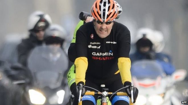 US Secretary of State John Kerry rides his bike during a break in Lausanne on 16 March 2015
