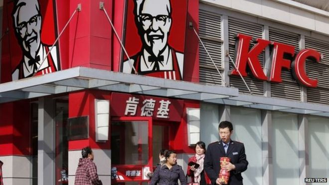 People walk past a KFC restaurant in Beijing, in this file photo taken October 23, 2013.