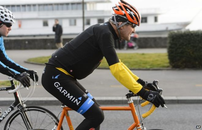 John Kerry, rides a bike after a bilateral meeting with the Iranian Foreign Minister in Lausanne on 16 March 2015