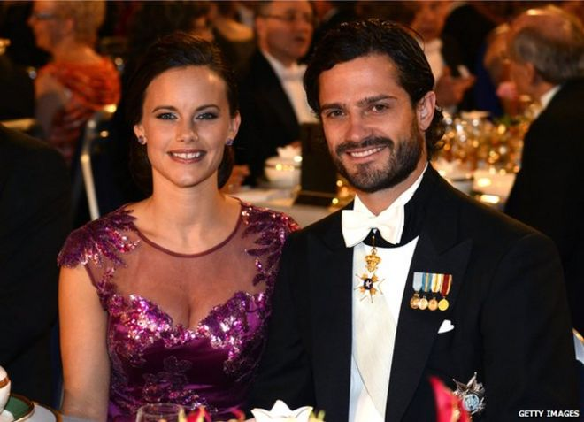 Prince Carl Philip of Sweden (right) and his fiancee Sofia Hellqvist at the Nobel banquet at the Stockholm City Hall on 10 December 2014.
