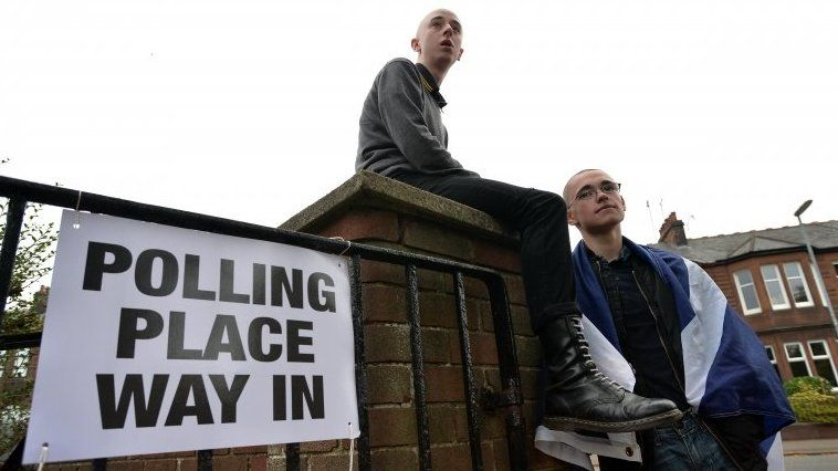 Young people outside polling station