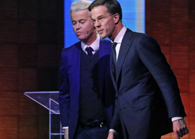 Mark Rutte (right) and Geert Wilders leave after a national televised debate at Erasmus University in Rotterdam, Netherlands, 12 March