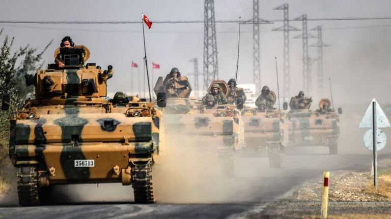 Turkish Army tanks driving to the Syrian Turkish border town of Jarablus