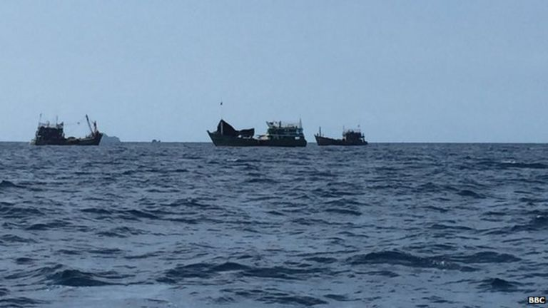 The boat surrounded by Thai fishing boats