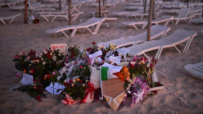 Flowers and tributes left on the beach