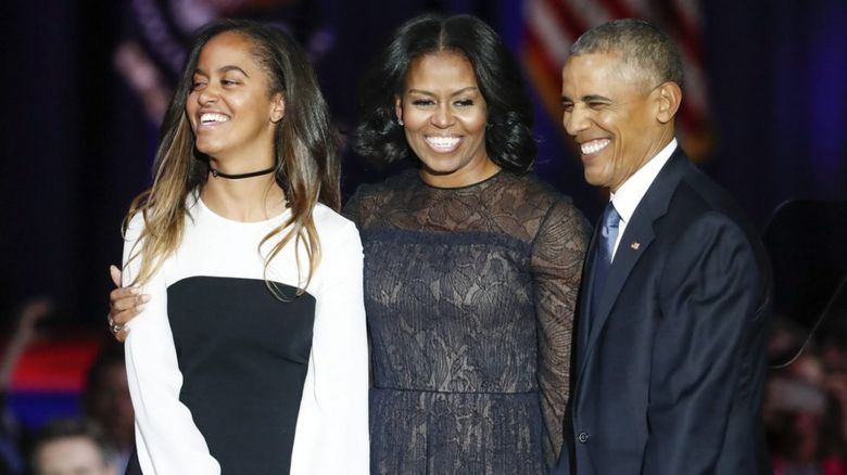 Malia, Michelle and Barack Obama