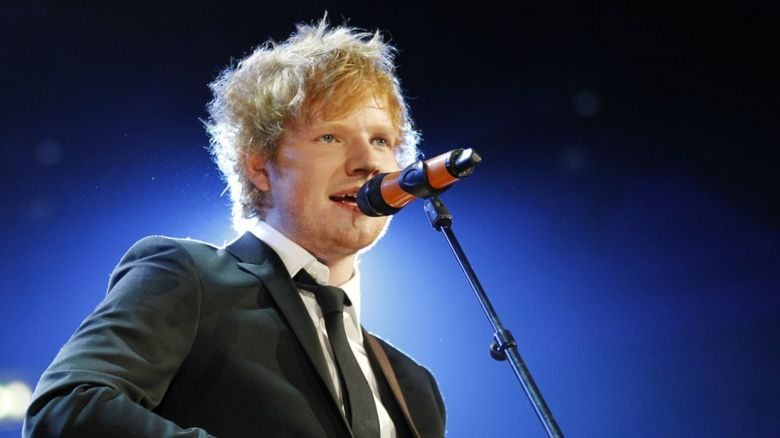 Ed Sheeran singing on stage