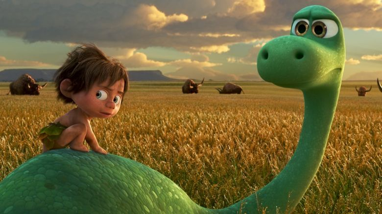 The animated characters of Spot, a boy and Arlo the good dinosaur